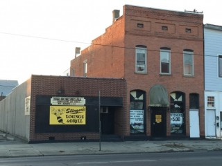 Foreclosure of London Bar and 2 Apartments