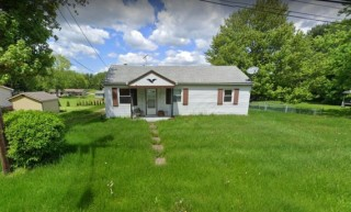 Stark Co. Ranch with 2 car garage on half acre